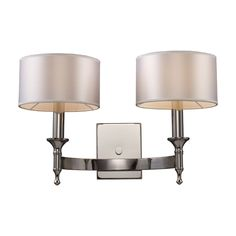 Unique in form, the Pembroke collection features a concave arm design for a distinct appearance. Choose from a Polished Nickel finish with light silver drum shades or Brushed Antique Brass with light tan shades.