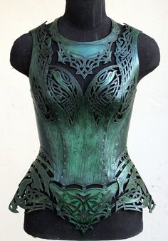 Where armor meets corset — utterly exquisite leather corsetry, painted to look like metal. Where armor meets corset — utterly exquisite leather corsetry, painted to look like metal. Fantasy Costumes, Cosplay Costumes, Worbla Cosplay, Costume Original, Kleidung Design, Leather Armor, Leather Corset, Tooled Leather, Fantasy Armor