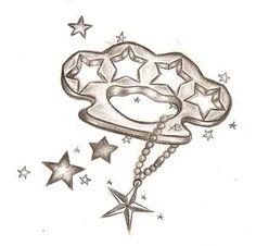 Brass knucles tattoo