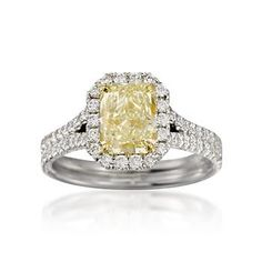 Dazzling fancy yellow diamond ring with a halo of diamonds.
