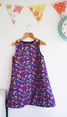 This reversible a-line dress sewing pattern will teach you how to make the perfect a-line dress for a baby girl or toddler sizes 0-24 months! A very simple, easy to sew pattern, it's suitable from beginner sewing level. It's completely reversible with buttons on both sides of the shoulders so it can be worn either way. You can also substitute snaps for the buttons if you'd rather not do the buttonholes. It also has plenty of room for embroidery, appliqué or decoration on the front or back.