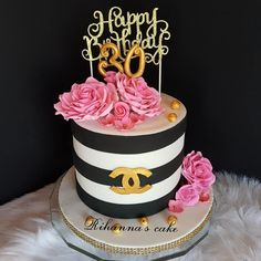 Chanel black and white and gold strip cake...with hand made pink rose flower... design by@hawraadosh Happy 30th birthday . . #Cakebakeoffng#chanel#chanelcake#cakes#chanelbirthdaycake#luxrycake#cakestyle#cakedesign#cakedecorating#cakebakeoffng#amazingcakes#instalove#instacake#instalove#inspirationalquotes#inspiration#كيك#فوندانت_كيك#cakeinstsgram#black#white#gold#chocolatecake#almondcake#amazing#Amazingcake#cakedefrance