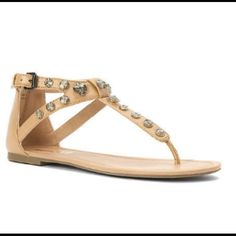 HUGE SALE STUDDED THONG SANDAL NIB. Tan faux leather. Rolled toe post for comfort. Back zipper entry. No modeling. No trades. Report Shoes Sandals