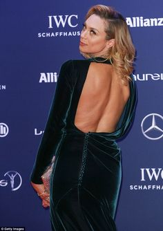 She's bringing sexy back! The 39-year-old smouldered in the backless number as she posed f...