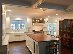 Historic kitchen with Carrara marble perimeter countertops and a butcher block island.  White kitchen by Stoneshop from Cherry Hill, NJ.