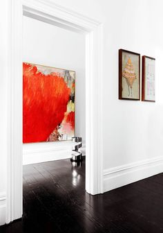 While respecting its heritage and period features the owner of this Sydney terrace injected a subtly modern aesthetic. The Guy Maestri work in the hallway creates a striking contrast to the dark floorboards which are also offset by bright walls. Black Floorboards, Black Wood Floors, Dark Flooring, Vinyl Flooring, Flooring Ideas, Laminate Flooring, Flooring Sale, Tile Flooring, Wood Laminate