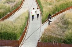 Urban Outfitters Headquarters at the Philadelphia Navy Yard by D.I.R.T. Studio corten planters ,grasses, rails, rubble