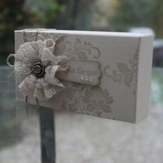 Little box in Sahara Sand cardstock, stamped in Sahara Sand Ink. Sahara Sand lace ribbon rosette with Antique Brad. Stampin Up.