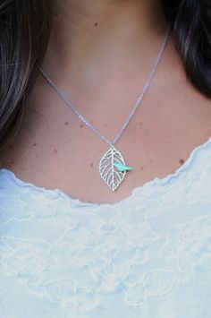 A silver leaf with a tiny blue/teal mother of pearl bird. What more could you ask for?! This necklace is just plain sweet. The chain has 2 length settings. One is at 16 inches and one is at 18 inches. The chain can be lengthened or shortened upon request.