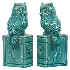 """Two ceramic statuettes of owls perching on books. Finished with a turquoise glaze.  Product: 2 Piece statuette setConstruction Material: CeramicColor: TurquoiseDimensions: 10"""" H x 4.5"""" W x 4"""" D each"""