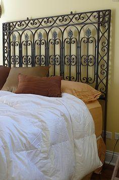 repurposing victorian era cast iron fence as headborards. Sweet.