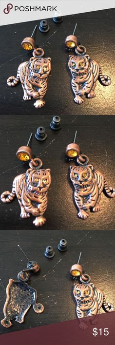 "Tiger Pierced Earrings Copper /Black tone Tiger Pierced Earrings Copper /Black tone. Never been worn.  Copper and Black tone with amber eyes and stone above the tiger. Tiger approximately 1"" tall x 3/4"" wide. Jewelry Earrings"