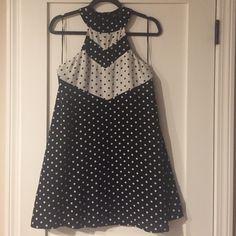 Vintage polka dot dress  Adorable halter-style, polka-dot dress. This dress is so cute! Will show off your shoulders & back! Fits a size small. Elliat Dresses