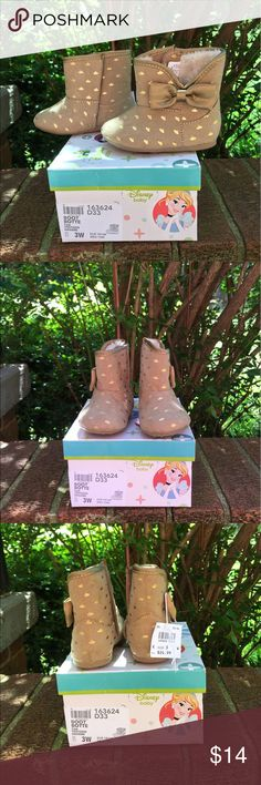 NWT Disney Baby Tan Crown Velcro Fur Bow Boots 3W New with tags Infant Girls Disney Baby Tan boots are size 3W. Boots Velcro closed on inside and on outside is a bow. Boots have little gold crowns all over them. Trim matches bow. Inside is Faux fur. Made in China. Fabric upper balance man made material. Boots are made of a soft suede like material. Disney Shoes Boots