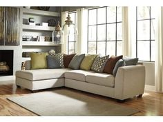 """The """"Casheral-Linen"""" upholstery collection features large contemporary shaped arms and plush seat and back cushions that makes this sofa and chaise sectional not only styled with a bright airy look that brightens any room, but also features the relaxing comfort perfect to complete any living area."""