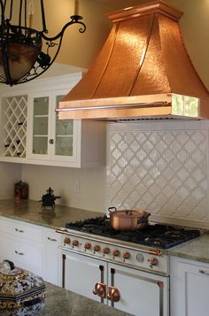 Copper range hood with white tile