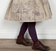illustrated skirt, purple stockings, brown boots