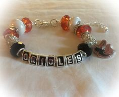 A personal favorite from my Etsy shop https://www.etsy.com/listing/244433842/baltimore-orioles-baseball-jewelry