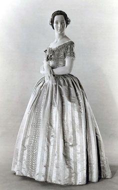 Wedding Dress    Date:      1847  Culture:      British  Medium:      silk  Dimensions:      Length at CB: 57 in. (144.8 cm) Length at CF: 50 1/2 in. (128.3 cm) Waist: 25 in. (63.5 cm)