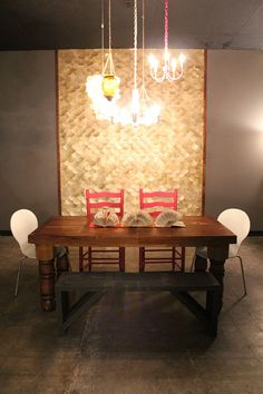 fish scale wall - Clever! Poster paper cut in circles, spraypainted, layered into a fishscale pattern on fiberboard, trimmed out, and hung in a dining room.  Great (and cheap) graphic statement!