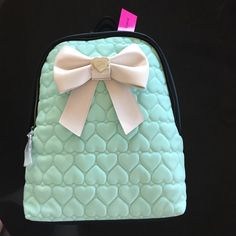 Betsey Johnson backpack Big beautiful Betsey Johnson backpack!  Teal waffle heart front and black back & sides with a big white bow on front!  New with tag attached. Betsey Johnson Bags Backpacks