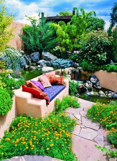 Susan Blevins of Taos, New Mexico, created an elaborate home garden featuring containers, perennial beds, a Japanese themed path and a regional style that reflects the Spanish and pueblo architecture of the area. CHARLES MANN PHOTOGRAPHY Santa Fe, NM