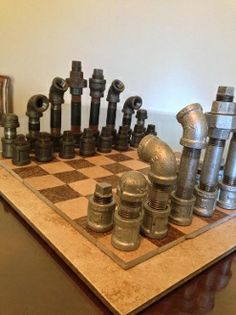 This Chess Set is so unique, you will never find anything like it elsewhere.  It is entirely made of metal pipe fittings from a local hardware store. The pieces are individually designed.  The base of each piece is 1 inch and the heights vary from 2 inches all the way to 6 inches.  The board is made out of an amazing quality Brazilian Slate mosaics. The base of the board is an  18 inches by 18 inches tile.  Very creative, very unique, and really ONE of a kind.