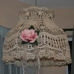 Handmade crochet lamp shade, this is a large shade that can be hung by itself from the ceiling as decor or used on a lamp. It has a nice pink rose with shimmery clear ribbon to give it a nice shabby/cottage chic look. This is a unique item, not store bought, and is therefore a nice piece of Americana art. $39