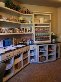 Laundry Room. Nice wrapping station, and loads of cubby holes for arts & crafts storage.