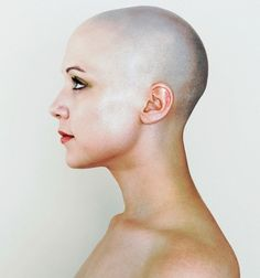 bald woman face side view