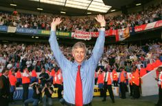 """Tottenham v Arsenal, 2004 Stuart says: """"The manager celebrates winning the league at White Hart Lane in front of the Arsenal fans. What makes this picture is the 'Arsène Knows' banner in the background."""""""
