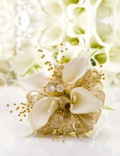 Prom Corsage of four mini white callas surrounded by golden glitter ribbon