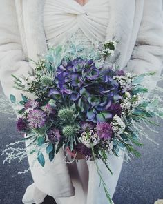 What a gorgepus bouquet full of my favourites .winter wedding bouquet with muted green and dusky pinks and purples. This bouquet by Jennifer Pinder contains hydrangea, sea holly (thistle), astrantia and wax flower xx Winter Wedding Flowers, Purple Wedding Flowers, Purple Roses, Wedding Colors, Spring Wedding, Purple Hydrangea Bouquet, Pink Purple, Purple Bouquets, Blue Wedding