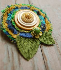 olive green textile brooch by peach parlor