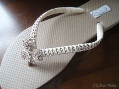 262cd10bbb08dd Items similar to Sand Flip Flops. CZ crystal bow Bridal flip flops. Ivory  Wedding flip flops. -Crystal Bow Collection. Sand 01 on Etsy