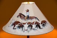 Choose the perfect painted leather lamp shade for your lamp and create the perfect rustic atmosphere for western lamps and southwest decor.  Genuine hand painted leather.