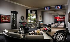 $5.495 Million Waterfront Home In Tequesta, FL With Bowling Alley