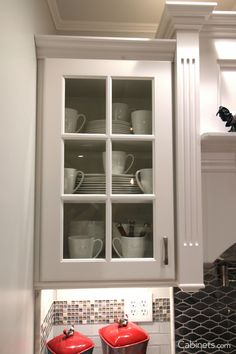 Trending - glass inserts in kitchen cabinets!