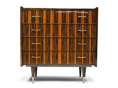 1960s Macassar ebony Chest of drawers designed and manufactured in France.  http://www.fearsandkahn.co.uk/etidrawers.htm