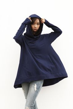 The cloak style hooded cotton top for you. Longer back and shorter front cambered hem is in the unique design technology. Fitting sleeves and