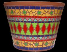Terracotta pot adorned with colourful tiles in the ancient inca style Incapot mosaic pot in ceramic tiles by Brett Campbell Mosaics