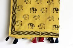 It's a Cotton hand block printed yellow dupatta with traditional elephant print on it. With beautiful tussles on it #chhapa