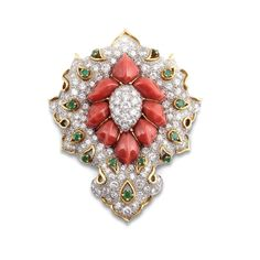 DAVID WEBB. A coral, emerald and diamond brooch.