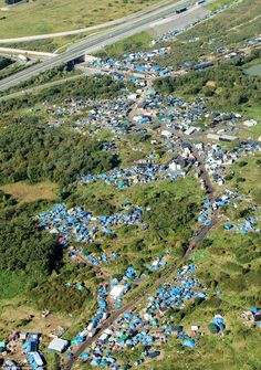Still growing: An aerial picture from October shows the Grand-Synthe migrant camp at a stage when it had just a few hundred residents