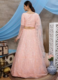 Elegance and honourable come together in this beautiful drape. Be an angel and create a smashing impact on everyone by wearing this peach net lehenga choli. The lovely embroidered and thread work a substantial feature of this attire. Comes with matching choli and dupatta. (Slight variation in color, fabric & work is possible. Model images are only representative.) Net Lehenga, Lehenga Choli Online, Indian Wedding Lehenga, Thread Work, Peach, Elegant, Fabric, Model, How To Wear
