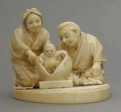 An attractive ivory Okimono, c.1880, of Momotaro, the Peach Boy arising from the fruit watched by his fond parents, incised Haru to, one figure detached, 9.3cm