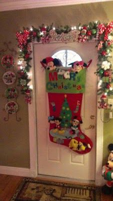 Mickey and Minnie Christmas door decor. Wow what a stocking. I love the plates. ask jen for oversize stocking Disney Christmas Decorations, Mickey Christmas, Christmas Themes, Christmas Crafts, Christmas Ornaments, Room Decorations, Christmas Sewing, Christmas Lights, Simple Christmas