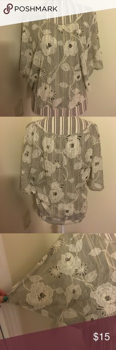 Sheer Floral Print Blouse loose fitted, shorter cut see through blouse with cute flower pattern. Worn a couple of times, in great condition. Has a wing look when worn I think the shirt looks like a light gray, my sister thinks it's more of a taupe. Charlotte Russe Tops Blouses