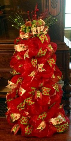 Deco mesh Christmas tree with ribbon accents. Your choice lighted or not. Hang on the wall, door, or sit on the floor. #Christmas