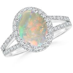 Split Shank Vintage Opal Ring with Diamond Halo ($1,959) ❤ liked on Polyvore featuring jewelry, rings, enhancer ring, opal jewelry, oval opal ring, vintage opal rings and diamond accent ring